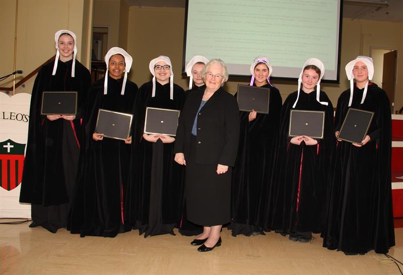Awarding Diplomas.jpg